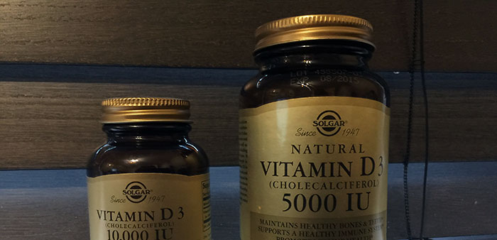 Two Vitamin D bottles manufactured by Solgar.  One is 5,000IU dry and the other is 10,000IU oil.